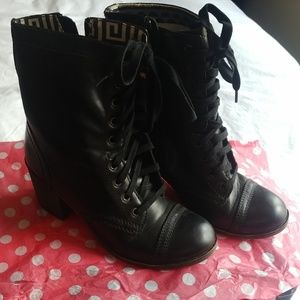 Heeled black lace up combat boots